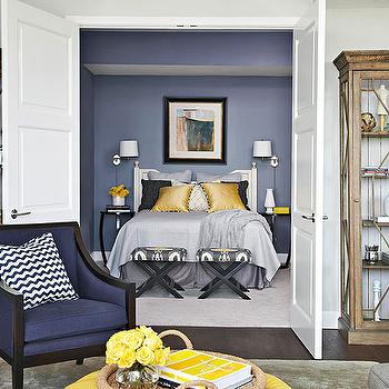 BHG - bedrooms - blue walls, blue bedroom walls, yellow and blue bedroom, yellow and blue bedroom design, white headboard, white wood headboard, swing arm sconce, bedroom sconces, bedroom reading lights, black lacquer nightstand, lacquer nightstand, glossy black nightstand, gray blanket, gray quilt, gray bed skirt, yellow pillows, yellow and black pillows, gray shams, ikat ottoman, x bench, x ottoman, ikat bench, ikat stool, yellow and gray ikat, yellow and gray ikat fabric, yellow and gray ikat ottoman, yellow and gray ikat stool, double doors, bedroom doors, bedroom double doors, double doors bedroom, Bansuri Fabric,