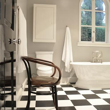 Kathleen Clements Design - bathrooms - master bathroom, master bath, gray bath walls, gray bathroom walls, palladian window, freestanding tub, floor mounted tub filler, checkered tile, checkered floor, checkered tile floor, black and white checkered tile, black and white checkered floor, black and white checkered tile floor, checkered bathroom floor, black and white checkered bathroom floor, glossy black door, medicine cabinet, medicine cabinet above toilet, medicine cabinet over toilet,