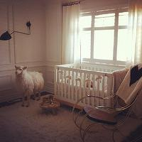 Bijou and Boheme - nurseries - nursery, chic nursery, boys nursery, boy nursery, decorative wall moldings, wall moldings, crib in front of window, white curtains, modern crib, modern nursery crib, white nursery crib, chrome rocking chair, modern chrome rocker, modern chrome rocking chair, flokati rug, white fluffy rug, toy sheep,