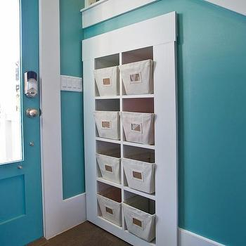HGTV - entrances/foyers - turquoise walls, turquoise wall color, turquoise entryway, hickory hardwood floors, dark hardwood floors, hickory floors, white trim, under stair storage, under stairs cubbies, built-in cubby storage, built-in storage with pull out bins, pull out bin storage, pull out canvas storage bins, entryway storage, turquoise paint colors, turquoise walls, turquoise foyer, turquoise entrance, turquoise wall paint, turquoise foyer walls, turquoise entrance walls,