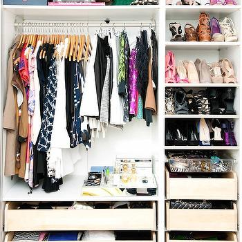 The Coveteur - closets - stylish closet, organized closet, small closet space, pull-out closet drawers, pull-out drawer storage, clothes rails, built-in closet storage, acrylic tray, pull-out acrylic tray, closet shelving, closet organization, clothes rails, clothes rack, styled closet, mirrored tray, shoe shelves, shoe storage, well organized closet,