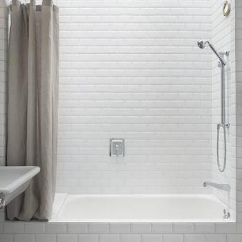 Mark Reilly Architecture - bathrooms - wall-to-wall skylight, skylight, bathroom skylight, white beveled subway tile, beveled subway tile, drop-in tub, shower bath combo, linen shower curtain, gray linen shower curtain, vintage style floor tile, gray half hex floor tile, half hex floor tile, Heath Ceramics Dwell Half Hex Tiles, beveled subway tile shower, beveled subway tile shower surround, beveled subway shower,