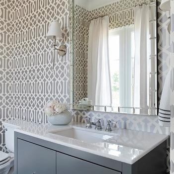 TRI Traci Rhoads Interiors - bathrooms - gray powder room, powder room, powder room, imperial trellis wallpaper, gray imperial trellis wallpaper, charcoal imperial trellis wallpaper, waterworks sconces, newell wall mounted sconce, mirrored tile mirror, gray vanity, gray bathroom vanity, gray washstand, gray cabinet, gray bathroom cabinet, white quartz countertop, ring pulls, ring pulls hardware, newell sconce, Kelly Wearstler Imperial Trellis Wallpaper in Charcoal, Waterworks Newell Wall Mounted Single Arm Sconce with Cone Shade,