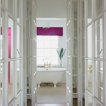 closets - bathroom hallway, mirrored cabinets, mirrored closet cabinets, floor to ceiling cabinets, floor to ceiling mirrored cabinets, herringbone floor, herringbone wood floor, claw foot tub, fuchsia roman shade,
