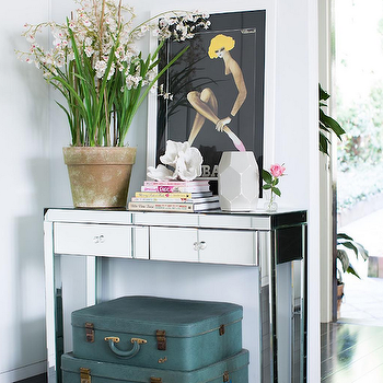 Adore Magazine - entrances/foyers - mirror foyer table, mirrored foyer table, mirrored foyer table, faceted vase, white faceted vase, stacked suitcases, decorative suitcases, teal suitcases, foyer, foyer table,