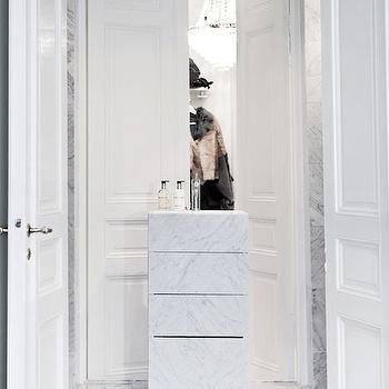 closets - walk in closets, bi fold doors, closet doors, bi fold closet doors, closet bi fold doors, closet island, marble closet island, crystal chandelier, closet chandelier,