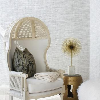 Lonny Magazine - bedrooms - bedroom sitting area, cane chair, dome chair, cane dome chair, faux bois pillow, lucite magazine holder, magazine holder, gold garden stool, gray textured wall,