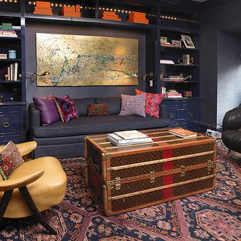 Elizabeth Bauer Design - dens/libraries/offices - purple office, office, purple walls, purple office walls, purple roman shade, purple built ins, purple built in cabinets, greek key doors, greek key cabinet doors, hermes box, gold leaf art, abstract art, gold abstract art, purple sofa, purple loveseat, purple pillows, purple rug, louis vuitton trunk, trunk coffee table, louis vuitton trunk coffee table, louis vuitton coffee table, vintage chair, yellow leather chair, purple throw, purple throw blanket, vintage black chair,