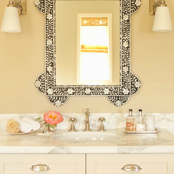 Taylor Borsari - bathrooms - cream bathroom, pale yellow walls, pale yellow bathroom walls, bone inlay mirror, white glass sconce, bathroom bone inlay mirror, bone inlay mirror, cream vanity, cream bathroom vanity, cream cabinet, cream bathroom cabinet, crea, vanity with white marble countertop, cream bathroom vanity with white marble countertop, cream cabinets, cream bathroom cabinets, cream cabinets with white marble countertop, cream bathroom cabinets with white marble countertop,