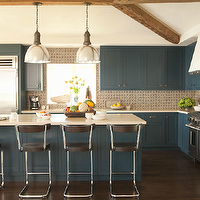 Taylor Borsari - kitchens - peacock blue, peacock blue cabinets, peacock blue kitchen cabinets, cream counters, cream countertops, mosaic tile backsplash, mosaic backsplash, industrial pendants, kitchen island pendants, vintage bar stools, vintage counter stools, exposed wood beams, dark wood floors,