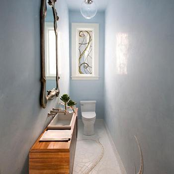 Marsh and Clark - bathrooms - narrow powder room, powder room, slim powder room, small and narrow powder room, super narrow powder room, blue powder room, unique powder room, blue walls, blue powder room walls, blue textures walls, floating vanity, floating bathroom vanity, wall mounted faucet, ornate mirror, mosaic tiled floor,