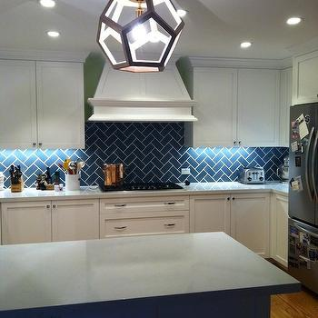 Nest Design - kitchens - white and blue kitchen, white and blue kitchen design, white shaker cabinets, white shaker kitchen cabinets, blue herringbone tile, blue herringbone tile backsplash, blue herringbone backsplash, blue kitchen island, light gray countertops, polyhedron pendant,