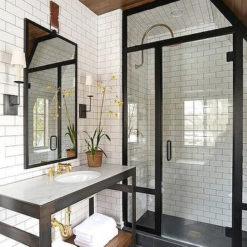 Amazing bathroom with wood sloped ceiling punctuated with antique brass lantern ...