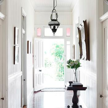 Toby Scott - entrances/foyers - long foyer, long entrance, long foyer design, long entrance design, long and narrow foyer, long and narrow entrance, beadboard foyer, foyer beadboard, beadboard walls, beadboard ceiling, baroque frame, gold baroque frame, vintage console table,