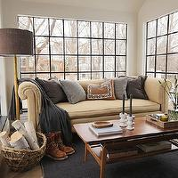 Summer Thornton Design - living rooms - steel windows, camel colored sofa, rolled arm sofa, camel sofa, camel rolled arm sofa, gray pillows, mid century modern coffee table, coffee table, black rug, floor lamp, brown lamp shade,