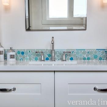 Veranda - bathrooms - white vanity, white bathroom vanity, built-in vanity, built-in bathroom vanity, single bathroom vanity, polished nickel hardware, polished nickel drawer pulls, white counters, white countertops, blue glass bubble mosaic, blue round mosaic tiled backsplash, turquoise round mosaic tile, turquoise round mosaic tiled backsplash, blue flower pot, blue hand towel, towel ring, pivot vanity mirror, pivot wall mirror, sconces, Mosaic Glass Bubble Tile,