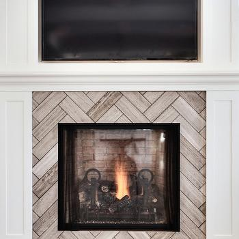 Veranda Interiors - living rooms: recessed flat screen, tv over fireplace, recessed tv over fireplace, hardwood floors, reclaimed hardwood floors, batten and board fireplace surround, white fireplace, herringbone tile, herringbone stone tiled fireplace surround, herringbone tiled fireplace surround, herringbone fireplace,