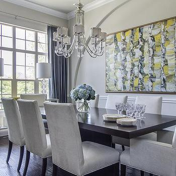 EJ Interiors - dining rooms - glass lamps, wing chairs, hydrangeas, wall art, wood table, dining room, chandelier, wood floors, gray walls, decanters, chair rail, china dishes, crystal, console table, velvet dining chairs,