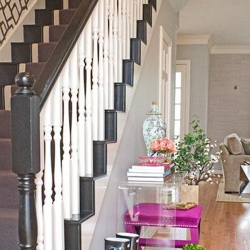 Lauren Haskett Fine Design - entrances/foyers - foyer table, acrylic console table, acrylic foyer table, hot pink ottoman, x ottoman, pink x ottoman, x base ottoman, zimba wallpaper, gray stair runner, black and white staircase,