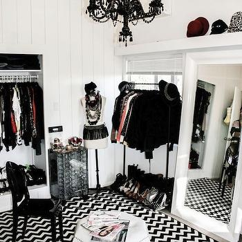 Lauren Messiah - closets - bedroom closet, bedroom converted into closet, bedroom converted to closet, shelves for shoes, chevron rug, black and white rug, black and white chevron rug, closet, walk in closet, shoe tray, closet chandelier, black closet chandelier, black chandelier, glossy black chandelier, black ghost chair, hex ottoman, white hex ottoman, hexagon ottoman, white hexagon ottoman, white floor mirror, beveled floor mirror, white beveled floor mirror,