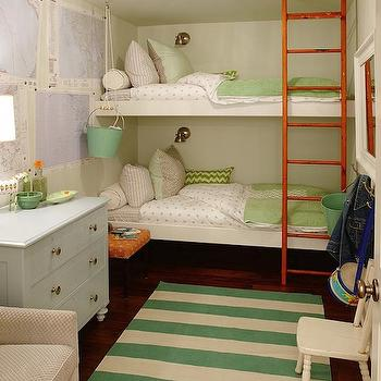 Sarah Richardson Design - girl's rooms - hardwood floors, dark hardwood floors, striped rug, green and white striped rug, vintage blue dresser, powder blue dresser, bunk beds, bunk room, bunkroom, girls bunk beds, girls bunkroom, girls bunk room, greige armchair, white kids chair, white framed mirror, bunkbed ladder, bunk bed ladder, orange stool, maps, map art, map wall decor, striped girls bedding, striped kids bedding, polka dot bedding, polka dot kids bedding, green and white chevron pillow, chevron pillow, green coverlet, bucket on pulley, girls room, girls bedroom, green and white girls bedroom, floating bunk beds, built in bunk beds,