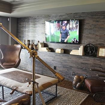 The Fat Hydrangea - media rooms - tray ceiling, stone walls, floor to ceiling stone wall, stone accent wall, flatscreen TV, whatnots, leather chairs, man cave, man cave design, fabric coffee table, jute rug,