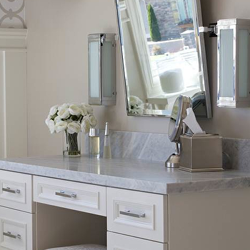 Belmont Design Group - bathrooms - make-up vanity, bathroom make-up vanity, ivory make-up vanity, marble counters, marble countertops, pivot wall mirror, pivot mirror, polished nickel and frosted glass sconces, modern polished nickel sconces, brushed nickel hardware, mirrored stool, mirrored make-up stool, cafe au lait walls, cafe au lait wall color, built-in make-up vanity, built-in dressing table, dressing table, vanity stool, mirror vanity stool, mirrored vanity stool,
