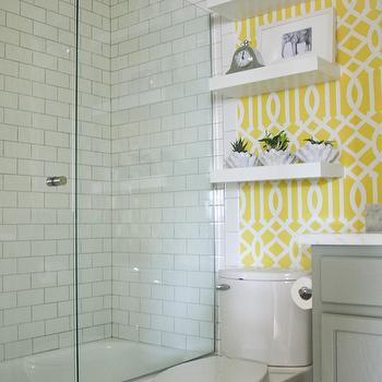 Sabbe Interior Design - bathrooms - floating shelves, white floating shelves, gray bathroom vanity, toilet, yellow and white trellis stencil, stenciled walls, trellis stencil, yellow and white trellis stenciled walls, yellow and white stenciled walls, stenciled bathroom walls, yellow and white bathroom, glass shower door, subway tile, white subway tile, white subway tiled shower surround, contrasting grout, gray grout, Etsy trellis OMGstencils, imperial trellis stencil, Etsy Trellis OMGstencil, Benjamin Moore Desert Twilight,
