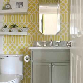 Sabbe Interior Design - bathrooms - yellow and white bathroom, floating shelves, white floating shelves, gray bathroom vanity, toilet, yellow and white trellis stencil, stenciled walls, trellis stencil, yellow and white trellis stenciled walls, yellow and white stenciled walls, stenciled bathroom walls, yellow and white bathroom, marble counters, marble countertops, polished chrome faucet, gray vanity, octagonal vanity mirror, beveled mirror, beveled octagonal mirror, Etsy trellis OMGstencils, imperial trellis stencil, Etsy Trellis OMGstencil, Benjamin Moore Desert Twilight,