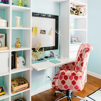 Natalie Clayman Interior Design - girl's rooms - built in desk, floating desk, girls desk, girls bookcase, black baroque frame, baroque frame bulletin board, baroque frame pin board, white desk, white floating desk, desk chair, pink and red chair, pink and red desk chair, bookcase, white bookcase, pink and blue rug, pink and turquoise rug, turquoise walls, turquoise blue walls,