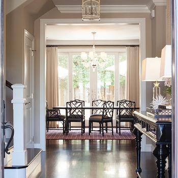 Kate Collins Interiors - entrances/foyers - foyer, entrance, foyer lanterns, entrance lanterns, black console table, black foyer table, crystal table lamps, gray tray, dark wood floors,