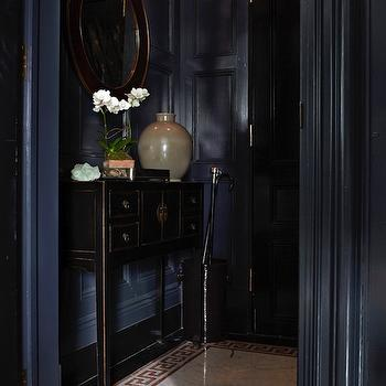 Sawyer Berson - entrances/foyers - greek key floor, greek key tiles, greek key, greek key border tiles, greek key border, paneled foyer, foyer wall paneling, navy blue paneling, navy blue paneled walls, black and gold mirror, black console table, black foyer table, chinese console table, altar table, black altar table,