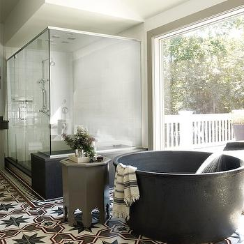 Elle Decor - bathrooms - zen bathroom, large glass shower, large walk in shower, oversized walk in shower, black bathtub, round bathtub, round tub, round black tub, round black bathtub, gray stool, moroccan stool, gray moroccan stool, star tiles, star tiled floor,