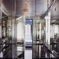 Miles Redd - bathrooms - mirrored dressing room, mirrored closet, mirrored walls, mirrored doors, mirror paneled walls, mirrored wall paneling, fluted mirror pilasters, mirrored room, black floors, dressing room, tiered crystal chandelier, black floors, mirrored wainscoting,