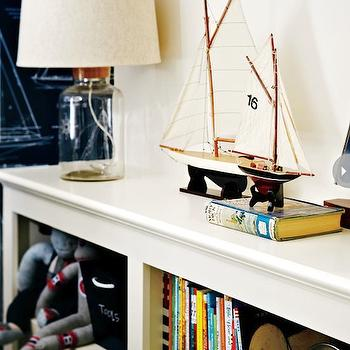 Style at Home - boy's rooms - model boats, model yachts, books, kids bookshelves, toys, canvas totes, glass bottle lamp, nautical bedroom, nautical kids room, nautical boys room, nautical playroom, play room, playroom, white bookshelves, bookshelves, boys bookcase, boys bookshelf,