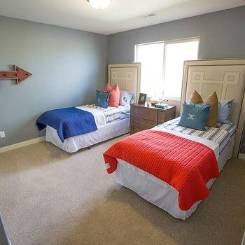 Henry Walker Homes - boy's rooms - twin headboards, nailhead trim headboard, tan colored headboard with nailhead trim, greek key headboard with nailhead trim, twin beds, red coverlet, blue coverlet, blue and white striped bedding, blue pillow, brown pillow, red pillow, white bed skirt, wooden nightstand, wood nightstand, carpet, wall to wall carpet, beige carpet, blue walls, blue wall color, arrow coat hook, red arrow coat hook, boys room, boys bedroom, twin boys bedroom, flush mount pendant, greek key headboard, twin greek key headboard,