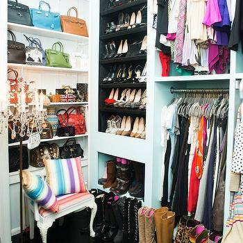 The Coveteur - closets - luxurious closet, turquoise closet, turquoise blue closet, turquoise walls, turquoise blue walls, turquoise closet walls, turquoise blue closet walls, built in shelves, closet shelves, closet shelving, shelves for shoes, built in shoe shelves,