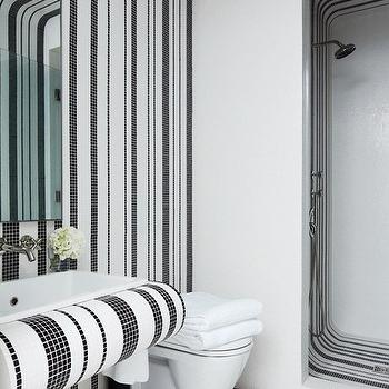 Architectural Digest - bathrooms: black and white bathroom, open shower, black and white shower, black and white tiled shower, black and white shower surround, wall mounted toilet, black and white vanity, wall mounted sink, black and white striped walls,