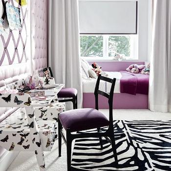 Architectural Digest - girl's rooms - purple girls room, princess bedroom, purple princess room, daybed, purple daybed, built in daybed, purple throw, purple throw blanket, light gray curtains, bed curtains, bed drapery, bed panels, light gray bed curtains, light gray bed panels, light gray bed drapery, bed valance, light gray bed valance, zebra rug, butterfly desk, butterflies desk, purple chair, black and purple chair, purple velvet wall, purple velvet accent wall, purple tufted walls, rug over carpet, rug layered over carpet, butterfly desk, butterflies desk, fornasetti butterflies desk, Fornasetti Desk,