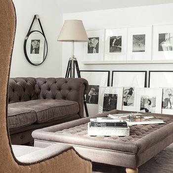 Sissy and Marley - living rooms - gray chesterfield, gray chesterfield sofa, gray ottoman, gray tufted ottoman, tripod floor lamp, black tripod floor lamp, captains mirror, black captains mirror, gray rug, picture ledges, photo wall, black and white photo wall,