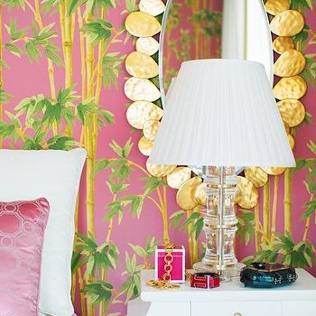 Adore Magazine - bedrooms - pink wallpaper, pink and green wallpaper, pink palm tree wallpaper, pink lacquer box, hot pink lacquer box, gold mirror, oval mirror, white lacquer nightstand, pink pillow, hot pink pillow, pink geometric pillow,
