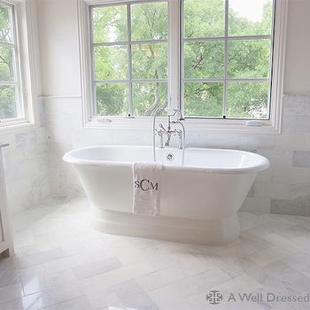 A Well Dressed Home - bathrooms - master bathroom, marble tiled floor, soaking bathtub, soaking tub, tub under windows, marble tiled walls, marble tiled floor,