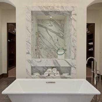 Kathleen DiPaolo Designs - bathrooms - gray tile, gray floor tile, gray tiled floors, walk-in shower, marble framed shower, window looking into shower, marble walk-in shower, marble shower surround, archways, arched doorways, floor mount faucet, floor mounted faucet, freestanding bath, freestanding tub, freestanding bath tub, tiered crystal droplet chandelier, crystal chandelier, crystal droplet chandelier, ivory walls, ivory wall color, rainfall shower head, tub in center of room, bathtub in center of room, center tub, center bathtub,