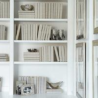 Linda McDougald Design - dens/libraries/offices - white built-ins, white bookshelves, built-in bookshelves, built-in shelving, matching books, matching book dust jackets, silver photo frames, silver bowls, silver framed art, , white paint colors, white paint,
