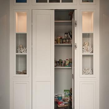 Walk In Pantry With Bi Fold Doors Flanked By Built In Display Cabinets