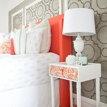 Sarah M. Dorsey Designs - bedrooms: orange headboard, upholstered headboard, orange upholstered headboard, orange fabric headboard, grasscloth, gray grasscloth, grasscloth wallpaper, gray grasscloth wallpaper, grasscloth wall panels, studded wall panels, studded grasscloth panels, orange colored headboard, wingback headboard, orange wingback headboard, border bedding, border shams, ornage pillow, embroidered pillow, orange pillow, orange embroidered pillow, studded wall panels, sherwin williams grasscloth wallpaper, ikea hack, skubb drawer, white nightstand, faux bamboo nightstand, white bamboo nightstand, white urn lamp, white and orange rug,