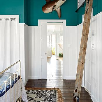 Country Living - boy's rooms - peacock blue, peacock blue walls, peacock blue paint, peacock blue paint colors, vertically paneled walls, vertical wall panels, reclaimed wood ladder, salvaged wood ladder, nantucket beadboard, white nantucket beadboard,