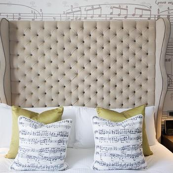 The Ampersand Hotel - bedrooms - tall tufted headboard, tall beige headboard, beige wingback headboard, beige headboard, beige tufted headboard, beige velvet headboard, beige velvet tufted headboard, chartreuse pillows, silk chartreuse pillows, sheet music pillow, sheet music wallpaper,
