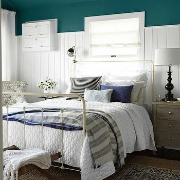 Country Living - bedrooms - Benjamin Moore - Oasis Blue - peacock blue, peacock blue walls, peacock blue paint, peacock blue paint colors, vertically paneled walls, vertical wall panels, nantucket beadboard, white nantucket beadboard, layered rugs, x bench,