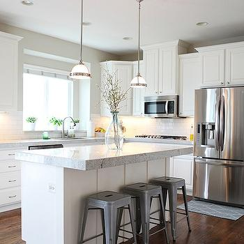 Jana Bek Design - kitchens - L shaped kitchen white cabinets, white kitchen cabinets, light grey countertops, subway tiled kitchen, subway tile backsplash, white subway backsplash, tolix stools, mini glass pendants, mini island pendants, microwave above range, cabinets above fridge,